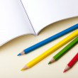 Color pencils on notebook — Stock Photo #20121447