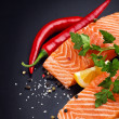 Fresh salmon on black plate - Stock Photo