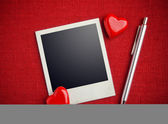 Photo and hearts on fabric background — Stock Photo