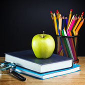 Teacher's desk with a color pencil, notebook and other equipment. — Stock Photo