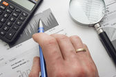 Close-up of specialist checking a financial analyze — Stock Photo