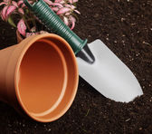 Close-up of the organic soil and spade — Stock Photo
