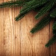 Branch of Christmas tree on old wood — Stock Photo