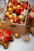 Colored Christmas balls in a wooden box — Stock Photo