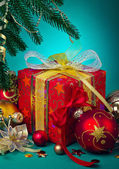 Red Christmas gift box and decoration — Stock Photo