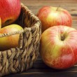 Red apples and basket — Stock Photo