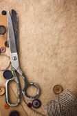 Old scissors and buttons — Stock Photo