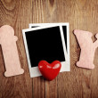 Blank instant photo and red heart — Stock Photo #40159759