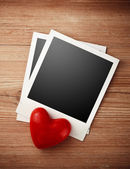 Two photo frames and red candy heart — Stock Photo