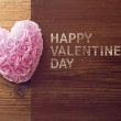 Old wooden background with heart shape — Stockfoto