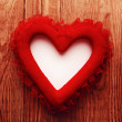 Foto Stock: Red heart on wood