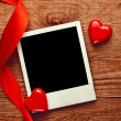Blank photo and small red hearts — Stock Photo