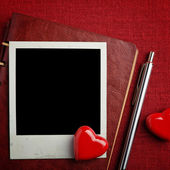 Notebook, photo and hearts — Stock Photo