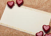 Red hearts on card — Stock Photo