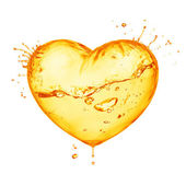 Heart from orange splash — Stock Photo