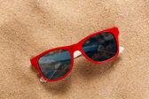 Sunglasses on beach — Stock Photo