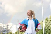 Young sporty girl holding basketball ball — Stock Photo