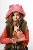 Teenage girl holding chihuahua dog — Stock Photo