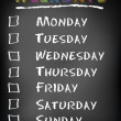 Conceptual weekdays list written on black chalkboard blackboard. Monday Tuesday Wednesday Thursday Friday Saturday Sunday. - Stock Photo