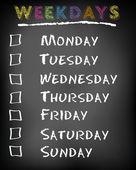 Conceptual weekdays list written on black chalkboard blackboard. Monday Tuesday Wednesday Thursday Friday Saturday Sunday. — Stock Photo