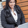 Stock Photo: Indian businesswoman with laptop