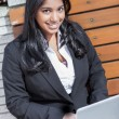Indian businesswoman with laptop — Stock Photo #13161111