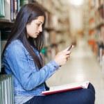 Hispanic student texting — Stock Photo #13161300