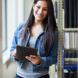 Hispanic college student using tablet PC — Stock Photo