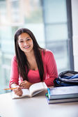 Hispanic college student studying — Stock Photo