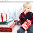 Boy with christmas gift — Stock Photo #5567379