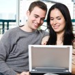 Happy couple browsing internet at home — Stock Photo #5567978