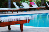 Deck chairs at poolside — Stock Photo
