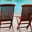 Two wooden chairs at the poolside — Stock Photo