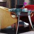 A modern glass dining table and chairs — Stock Photo
