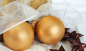 Christmas gift decorated with baubles and stars — Stock Photo