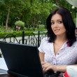 Girl with laptop in cafe — Stock Photo #3900589