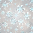 Seamless snowflakes background for winter and christmas theme. — Stock Vector