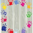Children hand prints on fence - Vektorgrafik