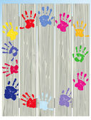 Children hand prints on fence — Stock Vector