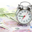 Alarm clock for euro banknotes — Stock Photo #13372874