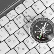 Computer keyboard and retro compass — Stock Photo #13711631
