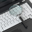 Stock Photo: Laptop with magnify glass