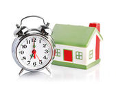 Toy House and alarm clock — Stock Photo