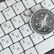 Computer keyboard and retro compass — Stock Photo #14045333