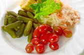 Pickled vegetables of tomato, cucumber, cabbage isolated — Stock Photo