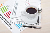 Accounting. Cup of coffee on document. chart and diagram — Stock Photo