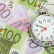 Alarm clock for euro banknotes — Stock Photo #14382669