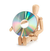 Wooden doll carries data storage media, CD or DVD — Foto de Stock