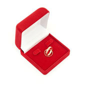 Wedding rings on red box — Stock Photo