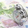 Foto de Stock  : Alarm clock for euro banknotes